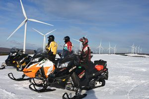 Snowmobilers take in the view in Bingham. Click on the image above for more Maine winter photos - Click on the image above to access more Maine winter images.