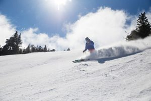 Skier at Sunday River - click on the image above or link below to access more Maine winter images.