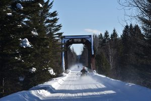 Snowmobiling in Washburn, Maine - Click on the image above to access more Maine winter images.