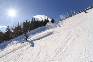 Sugarloaf skier - click on the image above or link below to access more Maine winter images.